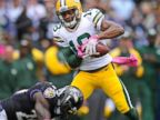 PHOTO: Green Bay Packers wide receiver Randall Cobb, right, takes a hit to the knee