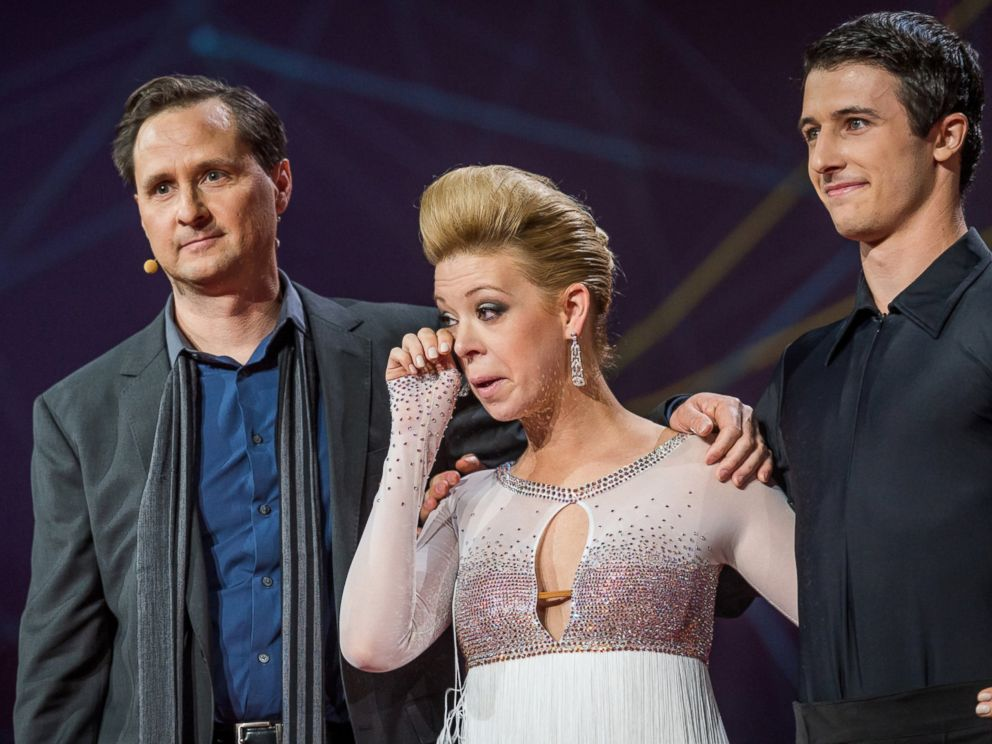 PHOTO: Dancer Adrianne Haslet-Davis, center, wipes away a tear while standing on stage with MIT professor Hugh Herr, left, and dancer Christian Lightner, at the 2014 TED Conference, March 19, 2014, in Vancouver, British Columbia.