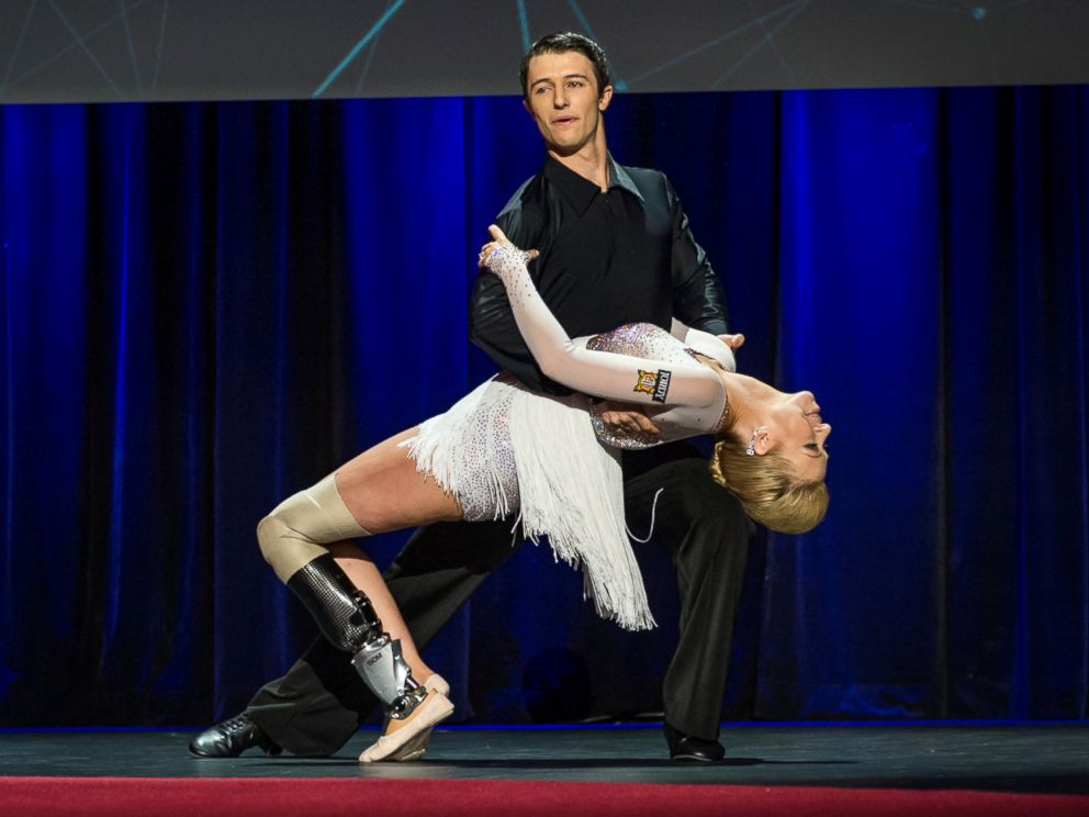 PHOTO: In this photo provided by TED 2014 Conference, dancer Adrianne Haslet-Davis, front, performs on stage with dancer Christian Lightner at the 2014 TED Conference, March 19, 2014, in Vancouver, British Columbia.