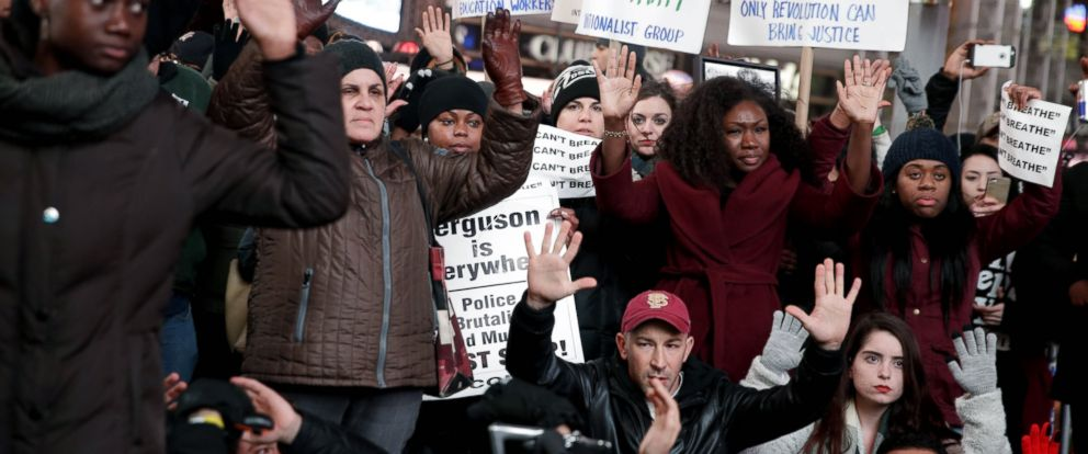 PHOTO: People participate in a protest in response to the grand jurys decision in the Eric Garner case in Times Square in New York, Dec. 3, 2014.
