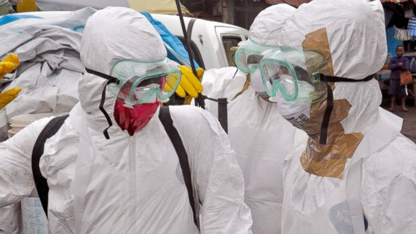 PHOTO: Health workers in protective gear leave after carrying the body of a woman that they suspect died from the Ebola virus, in an area known as Clara Town in Monrovia, Liberia, Sept. 10, 2014.