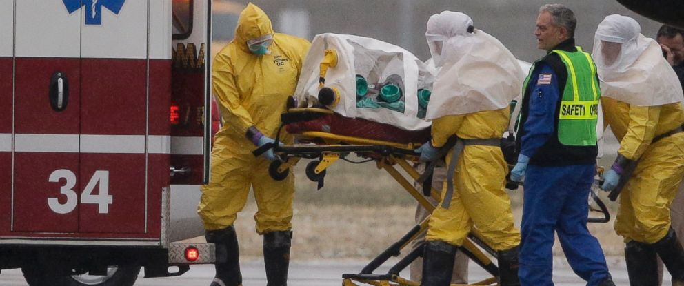 PHOTO: Health workers in protective suits transport Dr. Martin Salia, Nov. 15, 2014.