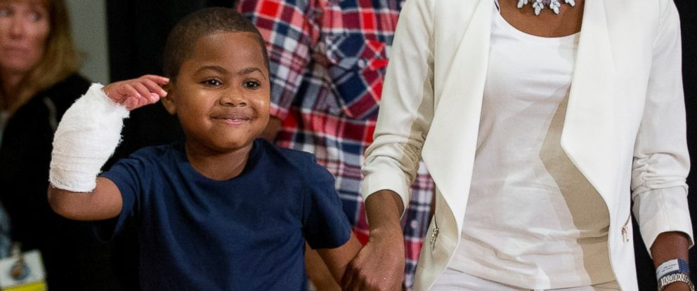 PHOTO: Double-hand transplant recipient, eight-year-old Zion Harvey, arrives to a news conference with his mother Pattie Ray on July 28, 2015 in Philadelphia.
