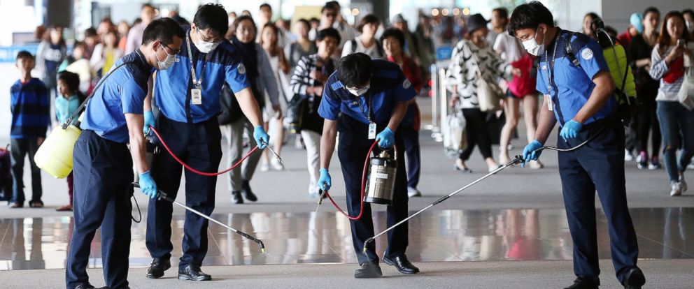 PHOTO: Workers spray antiseptic solution on the arrival lobby amid rising public concerns over the spread of Middle East Respiratory Syndrome (MERS), at Incheon International Airport in Incheon, South Korea, June 3, 2015.