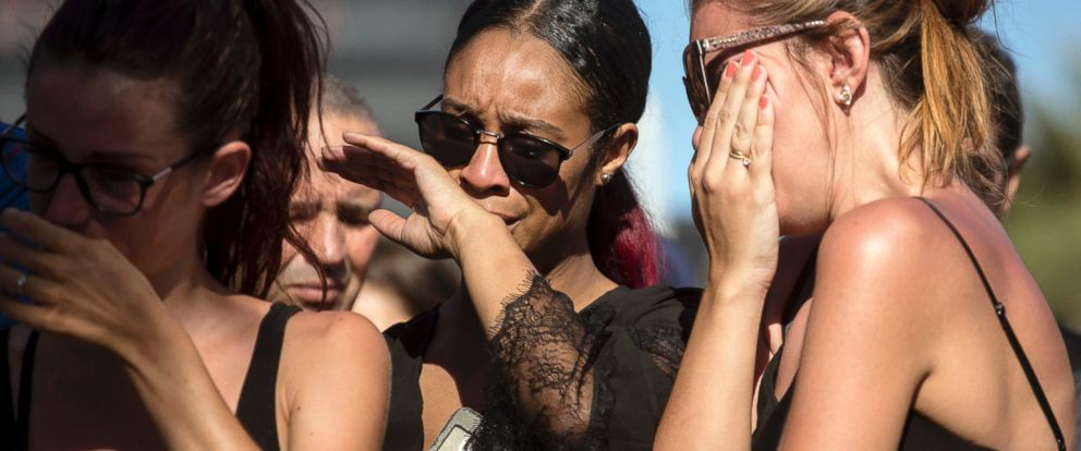 PHOTO: Women react near the scene of an attack where a truck mowed through revelers in Nice, southern France, July 15, 2016.