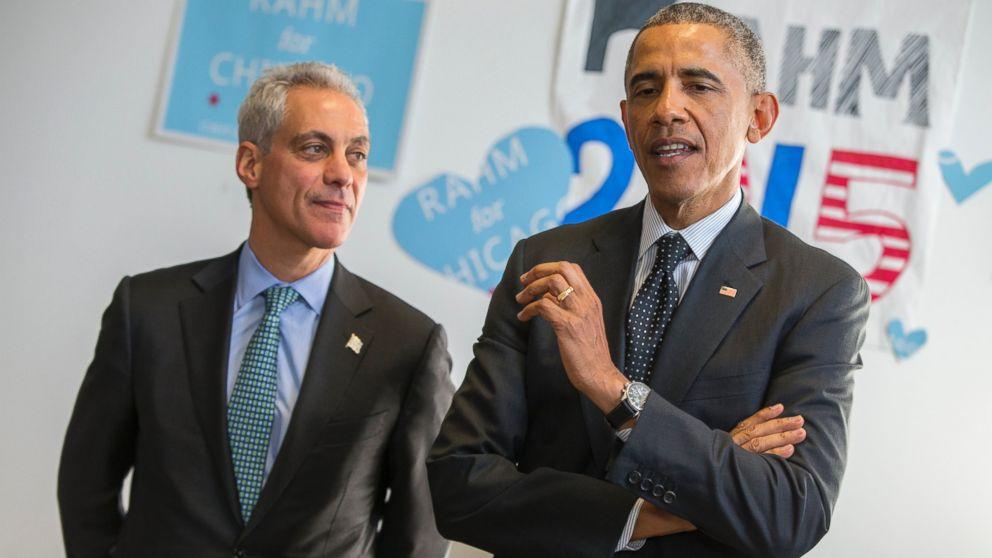 Chicago Mayor Rahm Emanuel listens as President Barack Obama speaks on behalf of Emanuel during a campaign stop in Chicago, Feb. 19, 2015.