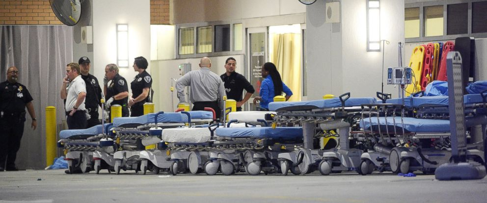 PHOTO: Emergency personnel wait with stretchers at the emergency entrance to Orlando Regional Medical Center hospital for the arrival of patients from the scene of a fatal shooting at Pulse Orlando nightclub in Orlando, Fla., June 12, 2016.