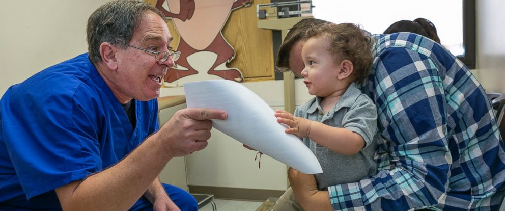 PHOTO: A pediatrician explains to a father the need of getting the measles-mumps-rubella vaccine, or MMR vaccine at his practice in Northridge, Calif., Jan. 29, 2015.
