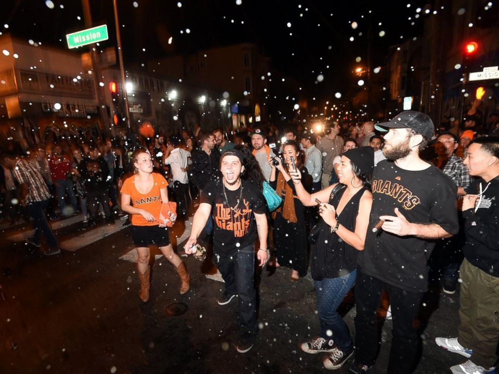 PHOTO: San Francisco Giants fans celebrate in the Mission district after the San Francisco Giants beat the Kansas City Royals to win the World Series on Oct. 29, 2014, in San Francisco.