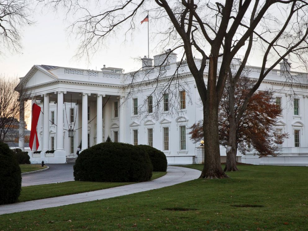 PHOTO: The White House in Washington is decorated with a red ribbon in honor of World AIDS Day, Dec. 1, 2014.