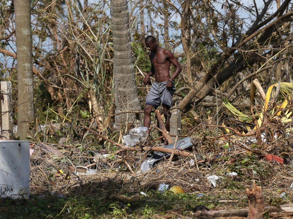 PHOTO: A man walks through the rubble after the passage of Hurricane Matthew in Playa Gelee, Haiti, Oct. 7, 2016. The death toll in Haiti by Hurricane Matthew rose to more than 400, according to South Civil Protection.