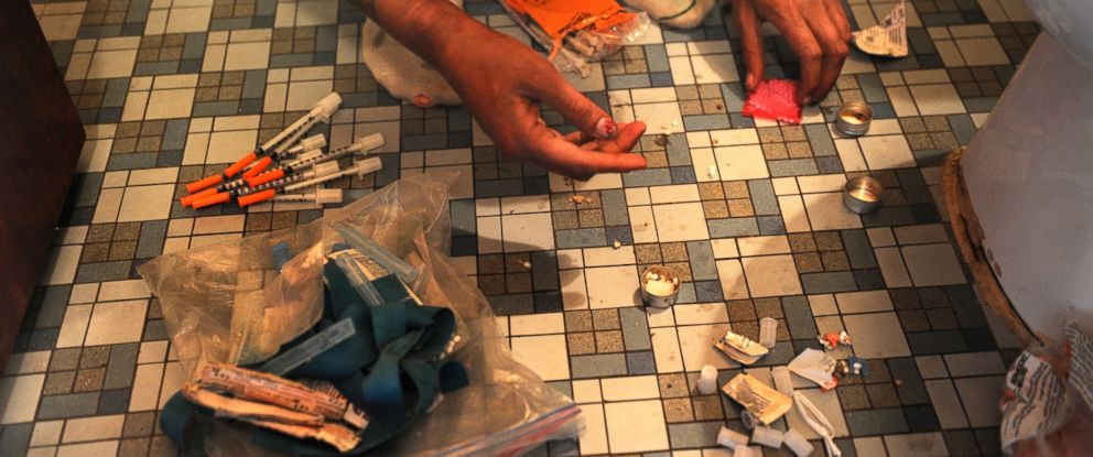 PHOTO: Heroin needles and paraphernalia are spilled out on a bathroom floor.