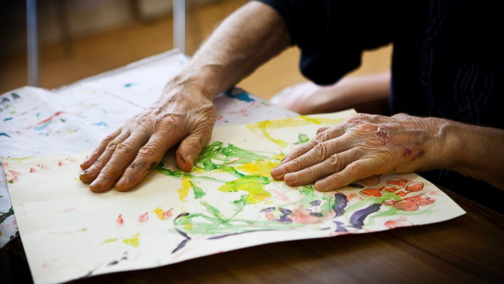 A patient participates in an art therapy class in a retirement home in Rueil Malmaison, France. This retirement home houses people suffering from Alzheimer's disease and related dementia.