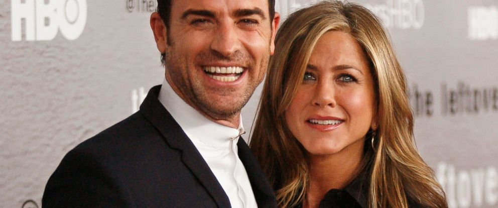 """PHOTO:Actors Justin Theroux and Jennifer Aniston attend """"The Leftovers"""" premiere at NYU Skirball Center, June 23, 2014 in New York."""