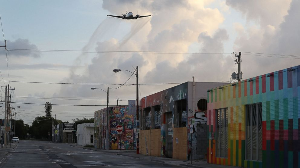 A plane sprays pesticide over the Wynwood neighborhood of Miami, FL in the hope of controlling and reducing the number of mosquitos, some of which may be capable of spreading the Zika virus on August 6, 2016.
