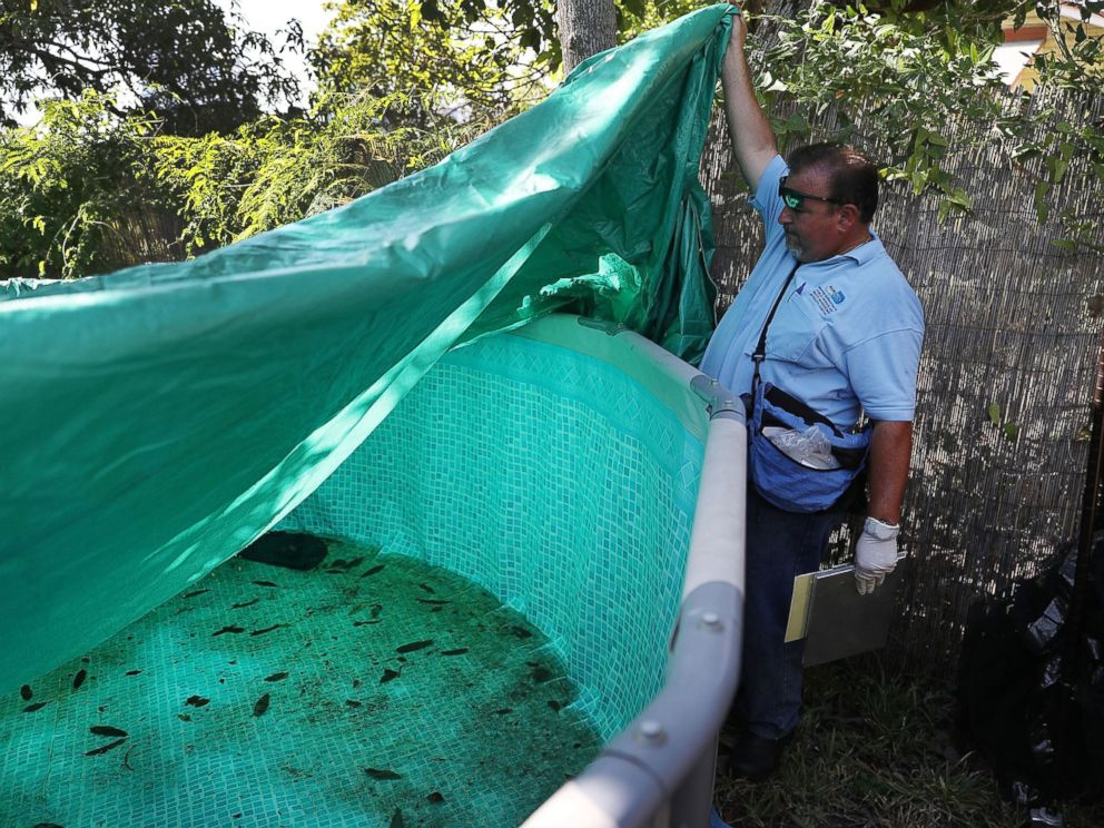 PHOTO: Robert Muxo, a Miami-Dade County mosquito control inspector, inspects a property for mosquitos or breeding areas in the Wynwood neighborhood as the county fights to control the Zika virus outbreak on July 30, 2016 in Miami.