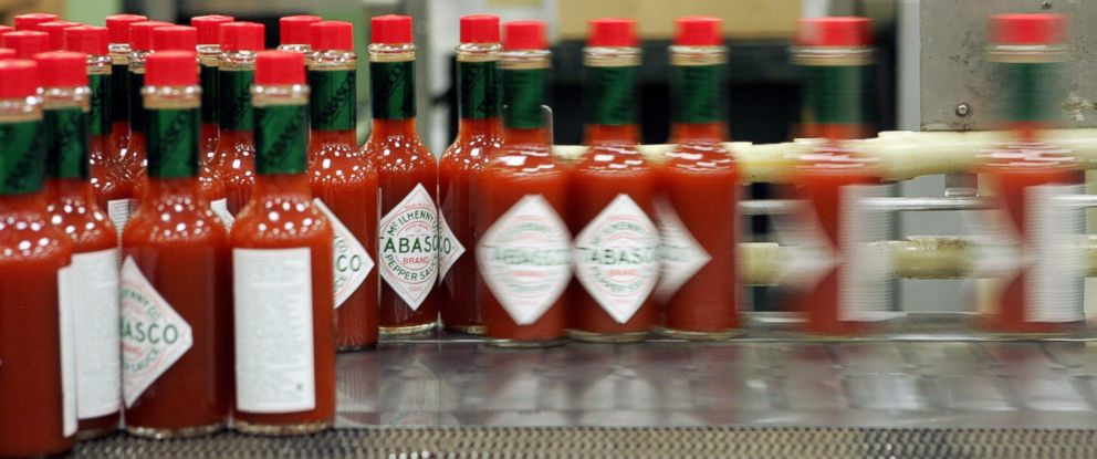 "PHOTO: Dozens of health workers in Texas are using Tabasco sauce to help drill for the next Ebola patient. If they get the tingly sauce on their skin during training, theyve been ""contaminated."" Bottles of Tabasco sauce are seen here in this file photo."