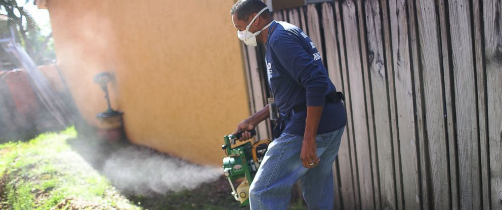 PHOTO: Larry Smart, a Miami-Dade County mosquito control inspector, uses a fogger to spray pesticide to kill mosquitos as the county continues to be proactive in fighting a possible Zika virus outbreak on May 26, 2016 in Miami.
