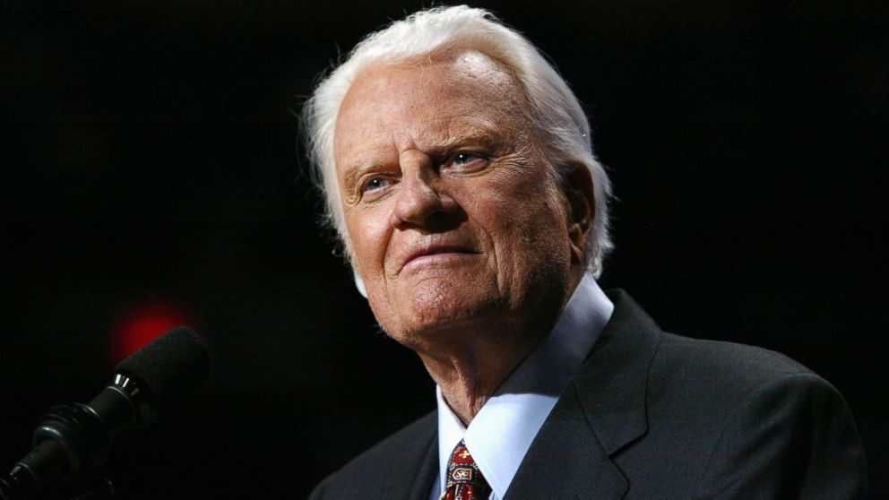 Evangelist Billy Graham looks on from the podium at a Billy Graham rally on June 13, 2003 in Oklahoma City, Okla.