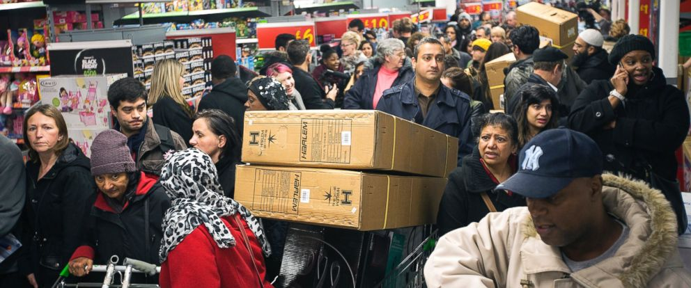 PHOTO: Customers push loaded shopping carts through crowded aisles as they look for bargains during a Black Friday discount sale inside an Asda supermarket in Wembley, London, Nov. 29, 2013.
