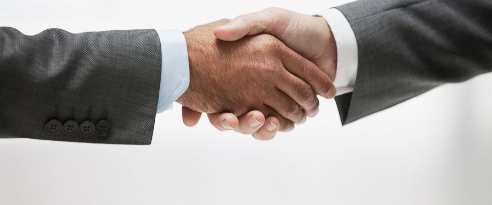 PHOTO: Two businessmen are pictured shaking hands in this stock image.