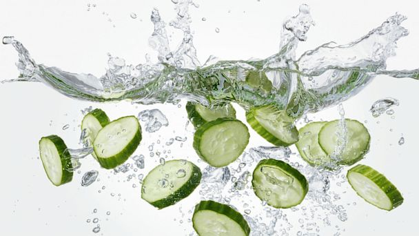 PHOTO: Slices of cucumber falling into water.