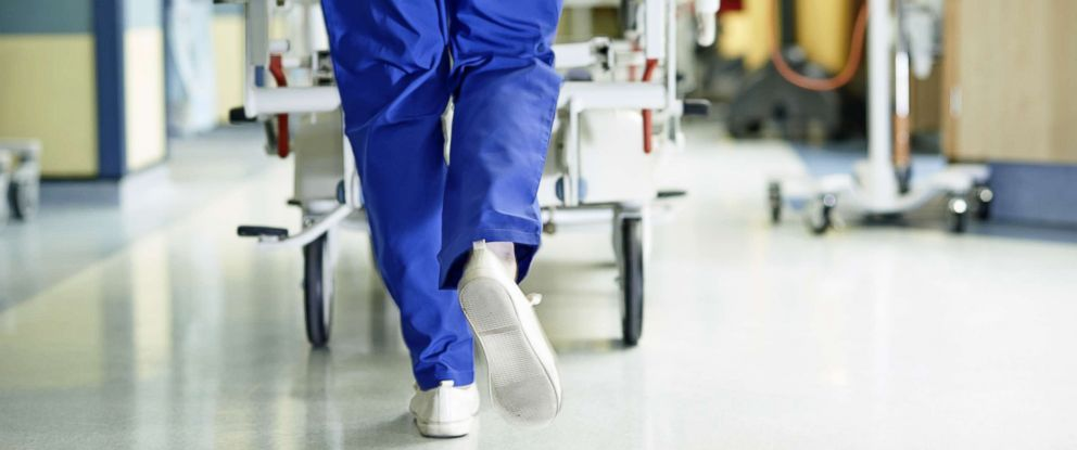PHOTO: A doctor walks down a hospital hallway.