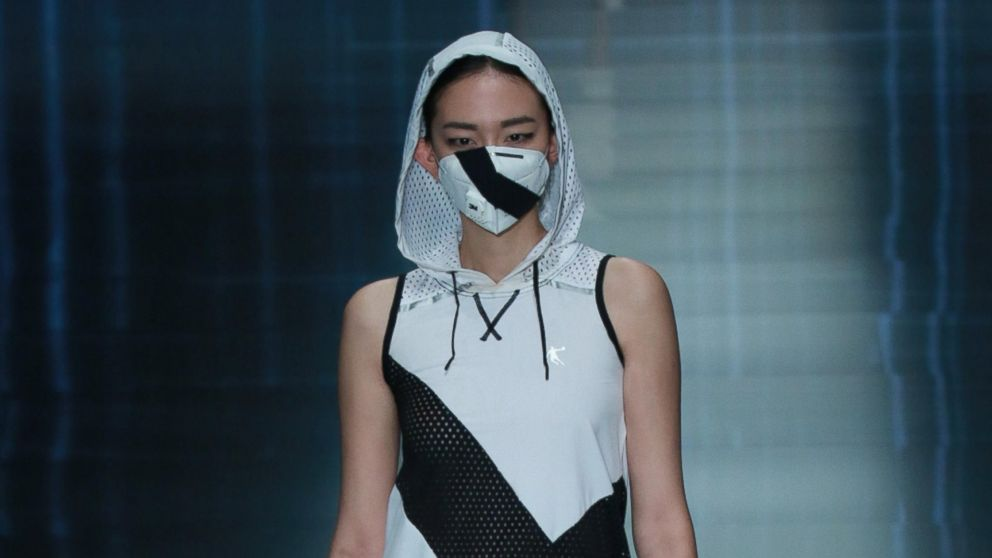 A model showcases designs on the runway at QIAODAN Yin Peng Sports Wear Collection show during the fourth day of the Mercedes-Benz China Fashion Week Spring/Summer 2015 at 751D.PARK, Oct. 28, 2014 in Beijing.