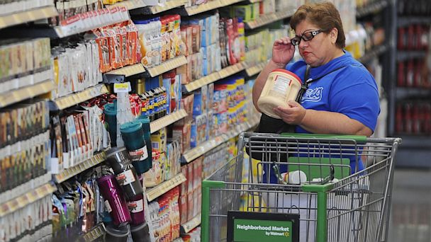 PHOTO: A shopper reads the label on a package of non-dairy creamer