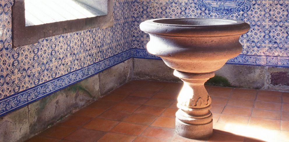 PHOTO: A holy water font is shown in the baptism area of a church.