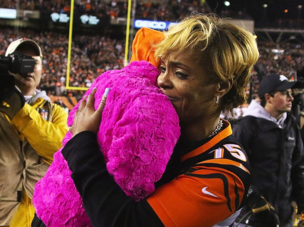 PHOTO: Leah Still, daughter of Devon Still #75 of the Cincinnati Bengals, is carried off of the field by her grandmother