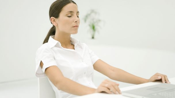 PHOTO: Meditating at work can help lower blood pressure.