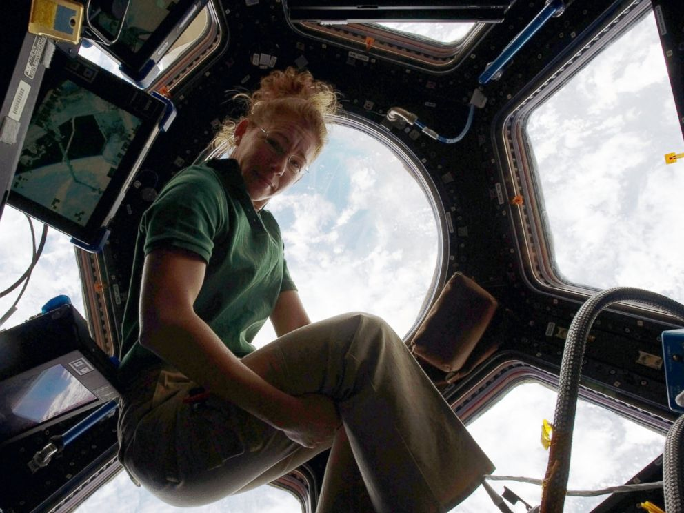 PHOTO: NASA astronaut Sandy Magnus, STS-135 mission specialist, gets one last visit to the Cupola onboard the International Space Station before the two spacecraft undocked, July 18, 2011, in space.
