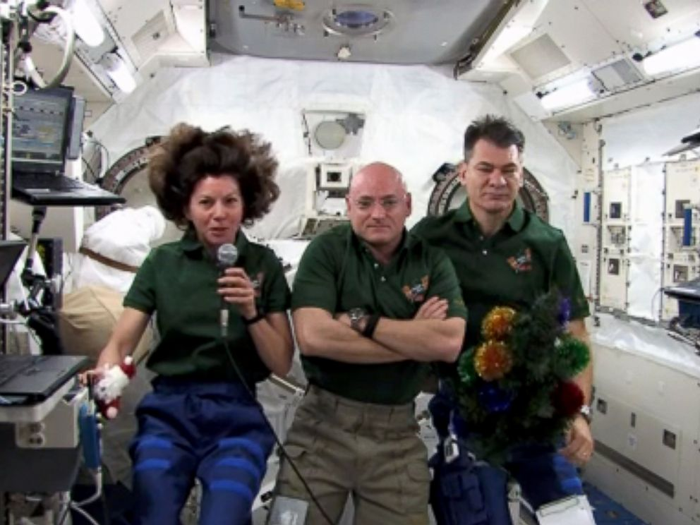 PHOTO: Flight Engineer Catherine Coleman, Commander Scott Kelly, and Flight Engineer Paolo Nespoli, memebers of the Expedition 26 crew, send their holiday greetings to Earth from the International Space Station, on Dec. 25, 2010 in space.