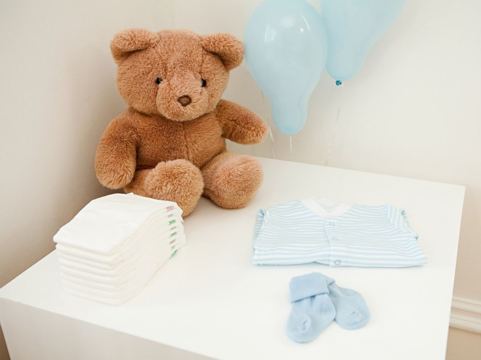 PHOTO: Baby clothes and teddy bear are set out for newborn baby in this undated stock photo.