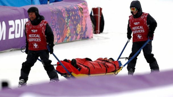 PHOTO: Italys Omar Visintin is carried off the course in a stretcher after crashing in the second semifinal of the mens snowboard cross at the Rosa Khutor Extreme Park, at the 2014 Winter Olympics, Feb. 18, 2014, in Krasnaya Polyana, Russia.