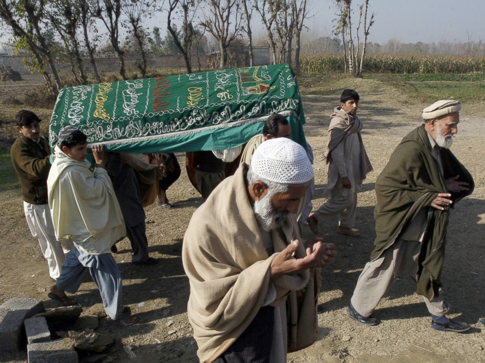 PHOTO: Mourners carry a coffin of a Pakistani charity worker, who was killed with other colleagues during yesterdays attack by gunmen, in Swabi, January 2, 2013.