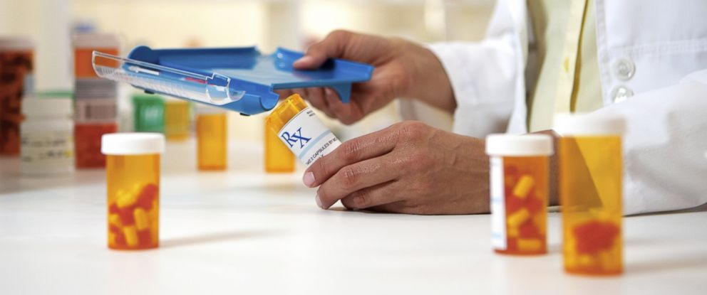 PHOTO: A pharmacist is pictured separating medications in this stock photo.