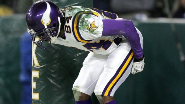 PHOTO: Randy Moss of the Minnesota Vikings pretends to moon the crowd after scoring a touchdown against the Green Bay Packers in the NFC wild-card game at Lambeau Field in Green Bay, Wis., Jan. 9, 2005. The Vikings defeated the Packers 31-17.