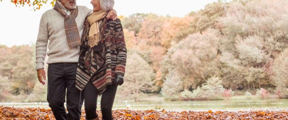 PHOTO: An elderly couple takes a walk in Autumn.