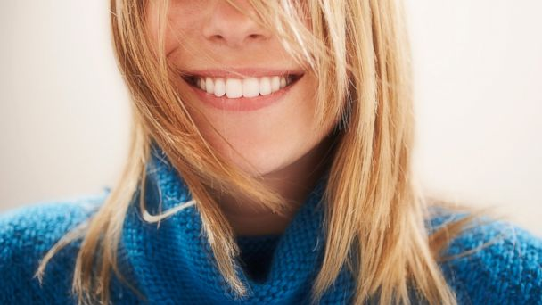 PHOTO: In this stock image, a young woman is pictured smiling.