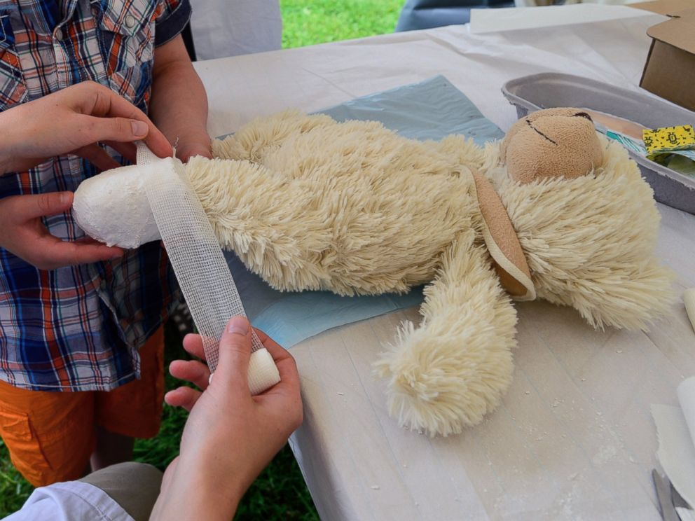 PHOTO: A teddy bear that belongs to a young boy gets a bandage at the Teddy Clinic on June 4, 2014 in Giessen, Germany.
