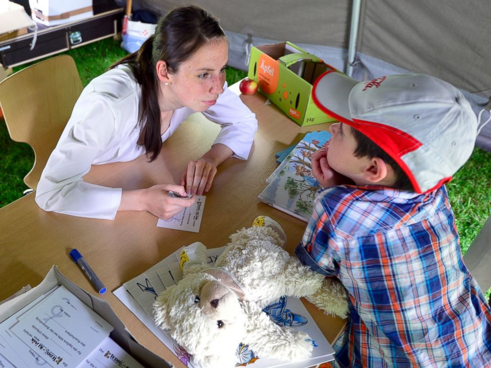 PHOTO: A child gets medicine for his teddy bear at the Teddy Clinic on June 4, 2014 in Giessen, Germany.
