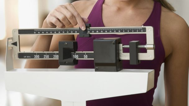 PHOTO: In this stock image, a woman is pictured using a scale.