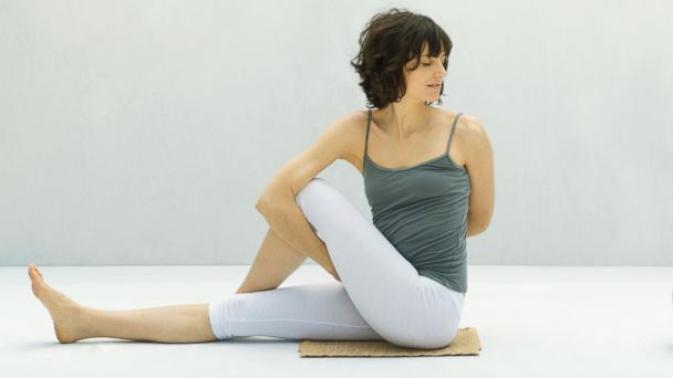 PHOTO: Practicing yoga can alleviate bloating.