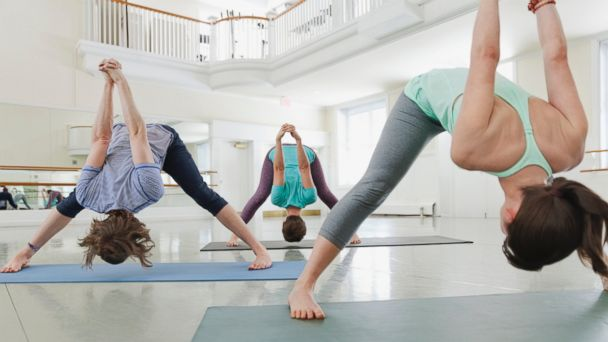 PHOTO: Group of people practicing yoga in yoga studio