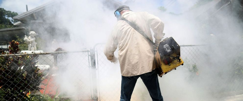 PHOTO: A Miami-Dade County mosquito control inspector uses a Golden Eagle blower to spray pesticide to kill mosquitos in the Wynwood neighborhood, as the county fights to control the Zika virus outbreak, Aug. 2, 2016, in Miami, Florida.