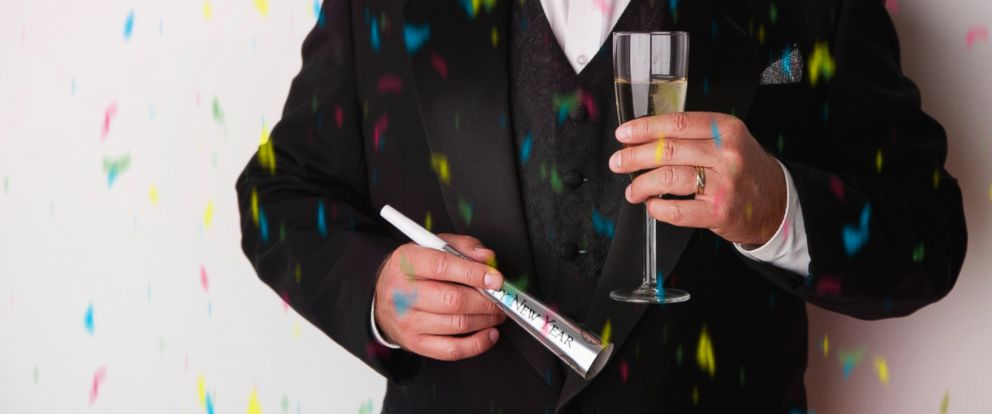 PHOTO: A man holds a glass of champagne at a New Years Eve party in this undated stock photo.