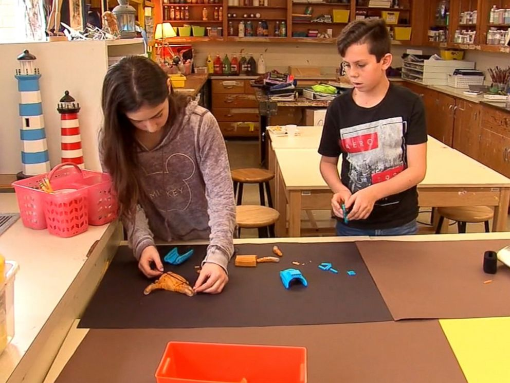 PHOTO: Eighth-graders at Howard B. Mattlin Middle School in Plainview, New York, are using a 3-D printer to create prosthetic hands for other children in need of them.