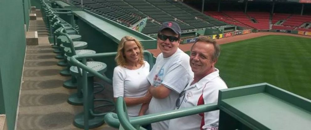 PHOTO: Applebees apologized to Caleb Dyl after he was not paid since starting his position in the kitchen last year. Dyl is pictured in a baseball hat with his parents during a trip to Fenway Park last year.